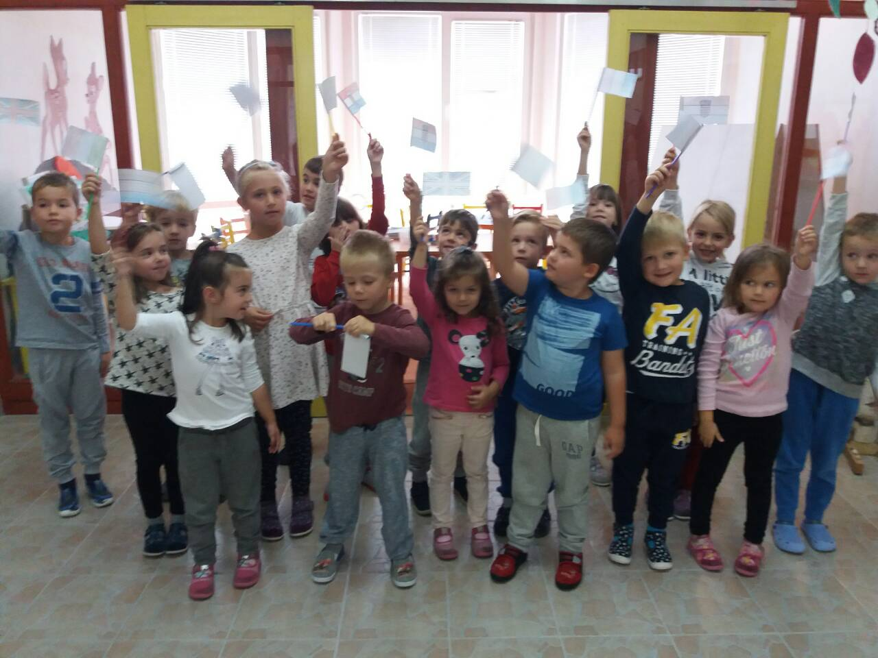 Flags of different countries and greetings in their official languages during the european day of languages two language teachers of secondary school kreevo in kreevo are going to visit kindergarten radost in kresevo m4hsunfo